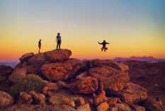 Global Nomadic Homepage image people jumping over rock