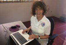 Margot B at desk